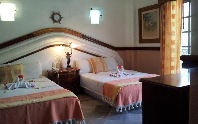 Отель Canadian Resorts Huatulco комната для гостей