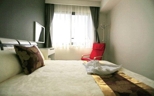 Отель Unixx Condominiums By Win 99 Group Паттайя комната для гостей