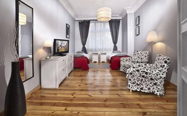 Отель Apartamenty Pomaranczarnia Познань комната для гостей
