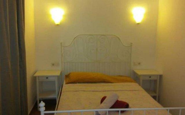 Отель Apartamentos Sant Cristofol Испания, Льорет-де-Мар - отзывы, цены и фото номеров - забронировать отель Apartamentos Sant Cristofol онлайн комната для гостей