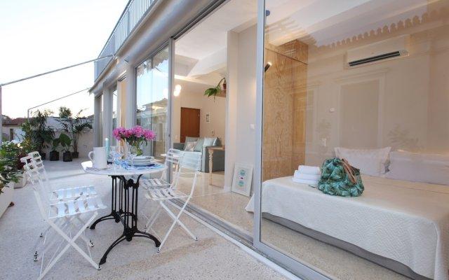 Отель Live in Athens Acropolis Suites вид на фасад