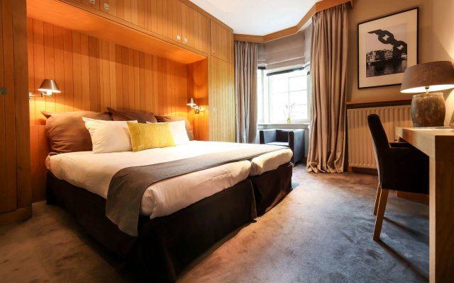 Отель The Delphi - Amsterdam Townhouse Амстердам комната для гостей