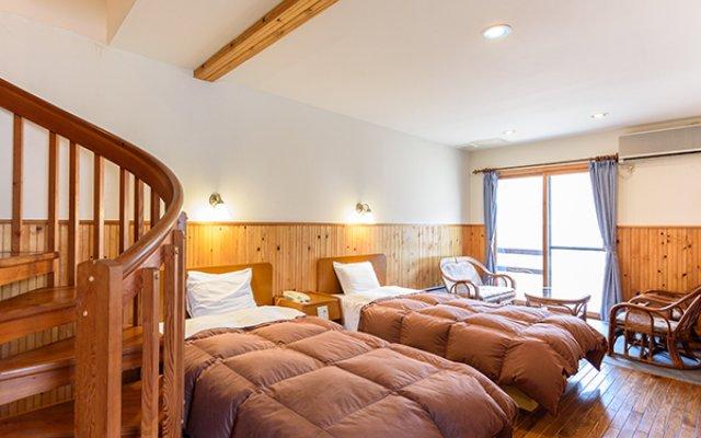 Отель Kinoko II Минамиогуни комната для гостей