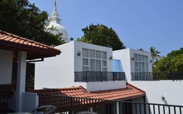 Отель Villa Baywatch Rumassala Шри-Ланка, Унаватуна - отзывы, цены и фото номеров - забронировать отель Villa Baywatch Rumassala онлайн вид на фасад