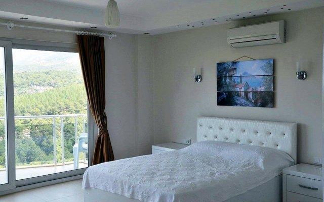 Villa Koru Турция, Патара - отзывы, цены и фото номеров - забронировать отель Villa Koru онлайн комната для гостей
