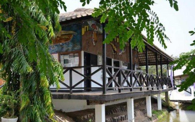 Отель Hans Cottage Botel Гана, Мори - отзывы, цены и фото номеров - забронировать отель Hans Cottage Botel онлайн вид на фасад