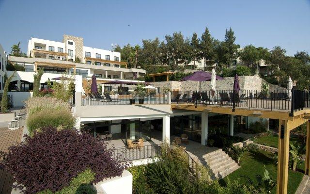 Отель Ramada Resort Bodrum вид на фасад