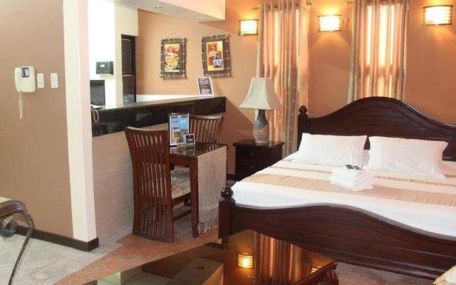 Отель Affinity Condo Resort - Luxury Hotel Филиппины, Пампанга - отзывы, цены и фото номеров - забронировать отель Affinity Condo Resort - Luxury Hotel онлайн комната для гостей