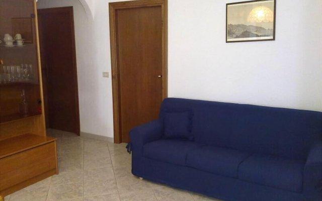 Отель Appartamenti Lucry Проччио комната для гостей