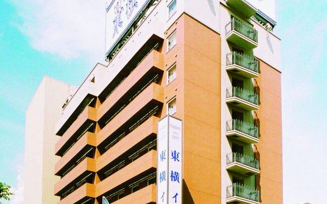Отель Toyoko Inn Hokkaido Tomakomai Ekimae Япония, Томакомай - отзывы, цены и фото номеров - забронировать отель Toyoko Inn Hokkaido Tomakomai Ekimae онлайн вид на фасад