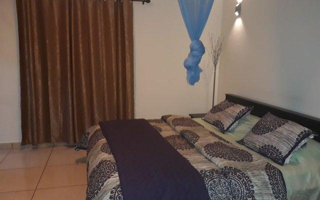 Atlantis Beach Hotel in Monrovia, Liberia from 155$, photos, reviews - zenhotels.com guestroom