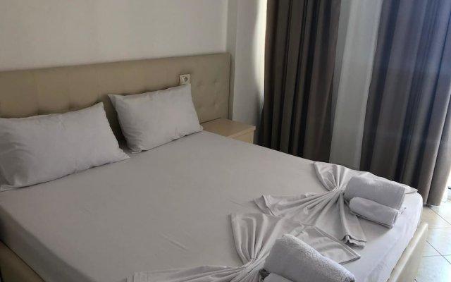 Апартаменты Sunny Bliss Apartments with Seaview Дуррес комната для гостей