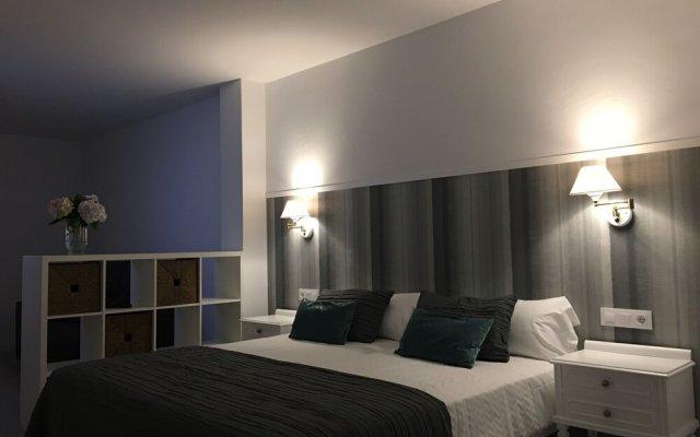 Отель Apartamentos Campana Эль-Грове комната для гостей