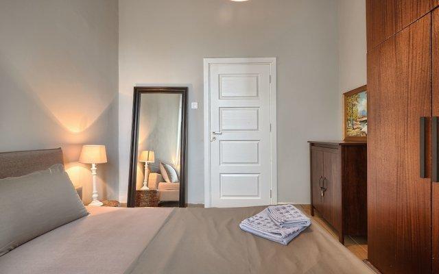 Апартаменты Baratero Downtown Apartment комната для гостей