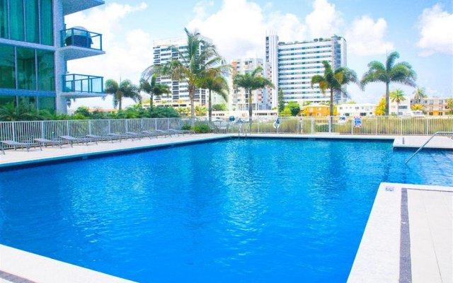 Отель Eloquence On The Bay Resort США, Норт-Бей-Виллидж - отзывы, цены и фото номеров - забронировать отель Eloquence On The Bay Resort онлайн бассейн