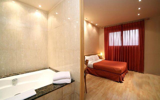 Отель Apartamentos DV Испания, Барселона - отзывы, цены и фото номеров - забронировать отель Apartamentos DV онлайн комната для гостей