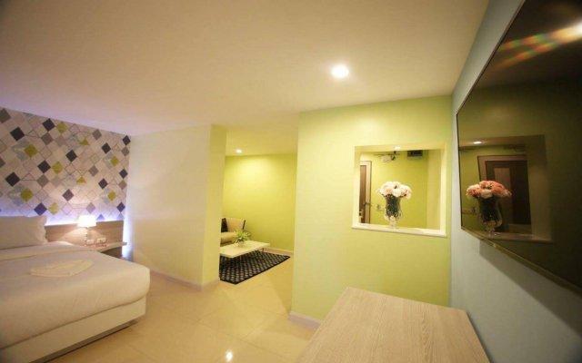 Апартаменты Trebel Service Apartment Pattaya Паттайя комната для гостей