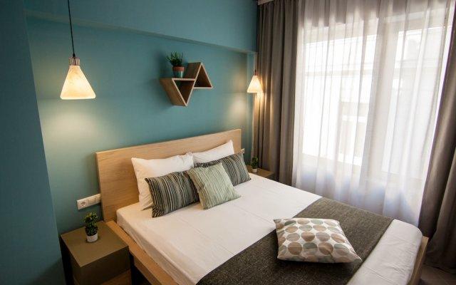 Отель Dynasta Central Suites комната для гостей