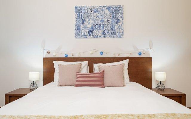 Отель Apartamento Lobo Marinho Португалия, Санта-Крус - отзывы, цены и фото номеров - забронировать отель Apartamento Lobo Marinho онлайн комната для гостей