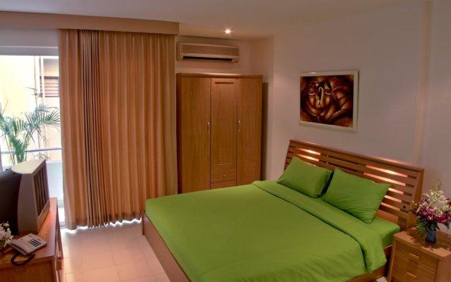 Апартаменты Mosaik Apartment Паттайя комната для гостей