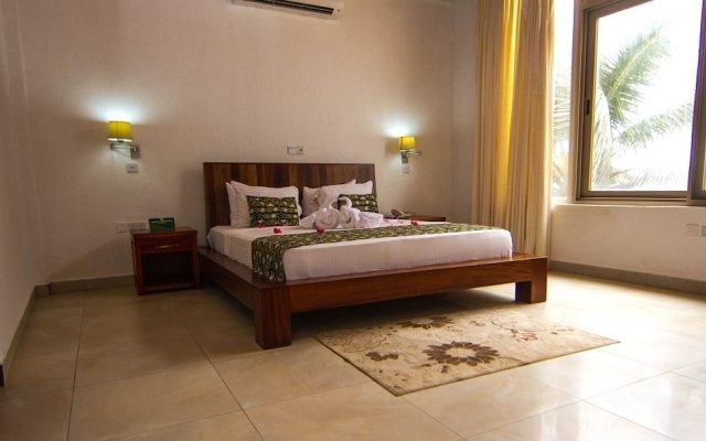 Отель Coconut Grove Beach Resort Гана, Шама - отзывы, цены и фото номеров - забронировать отель Coconut Grove Beach Resort онлайн комната для гостей