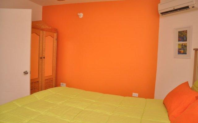 Апартаменты Palm View Apartment At Sandcastles комната для гостей
