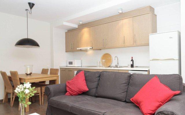 Апартаменты Paralelo Apartments комната для гостей