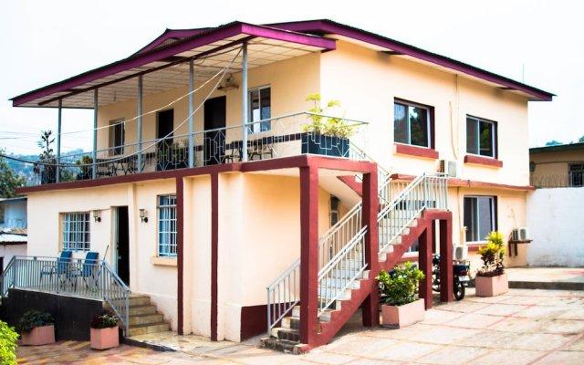 Отель Jam Lodge Сьерра-Леоне, Фритаун - отзывы, цены и фото номеров - забронировать отель Jam Lodge онлайн вид на фасад