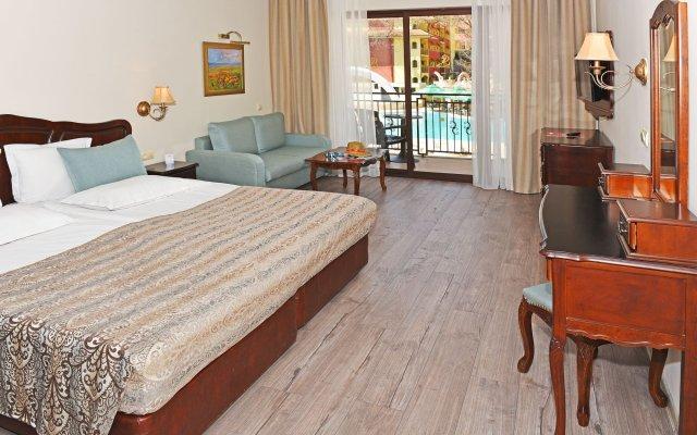 Отель Grifid Hotel Bolero & AquaPark Болгария, Золотые пески - отзывы, цены и фото номеров - забронировать отель Grifid Hotel Bolero & AquaPark онлайн комната для гостей