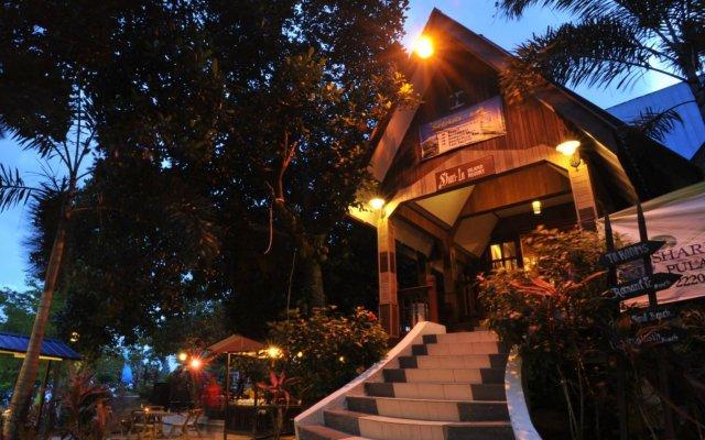Отель Shari-La Island Resort вид на фасад