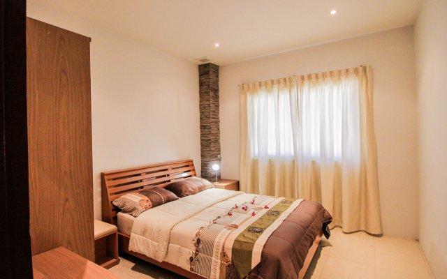 Апартаменты New Nordic Villas & Apartment by Pattaya Sunny Rentals Паттайя комната для гостей