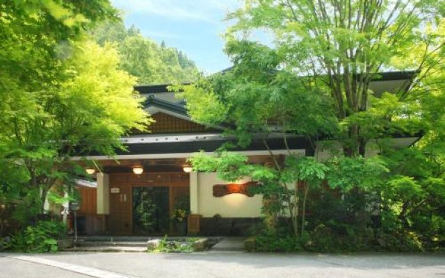 Отель Kurokawa Onsen Oku no Yu Минамиогуни вид на фасад