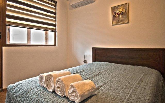 Апартаменты Travellino Serviced Apartments комната для гостей