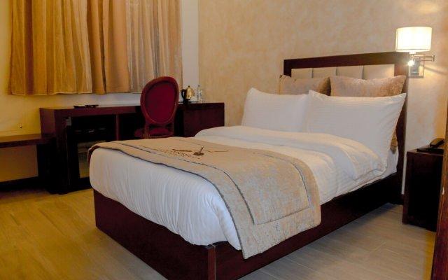 Отель Mamba Point Hotel Freetown Сьерра-Леоне, Фритаун - отзывы, цены и фото номеров - забронировать отель Mamba Point Hotel Freetown онлайн комната для гостей