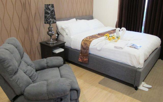 Отель The Crystal Condo Сирача комната для гостей
