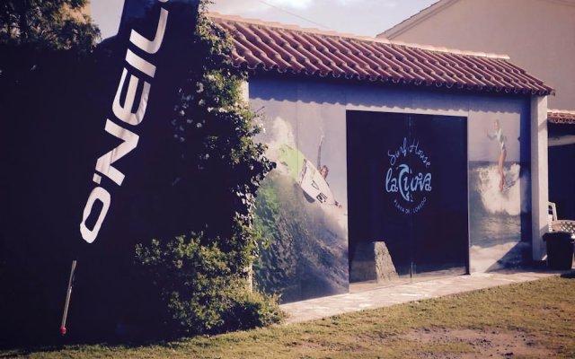 Отель La Curva Surfhouse Испания, Рибамонтан-аль-Мар - отзывы, цены и фото номеров - забронировать отель La Curva Surfhouse онлайн вид на фасад