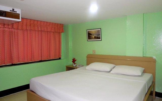 Отель Woodlands Inn Бангкок комната для гостей