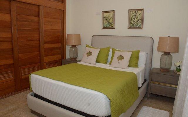 Отель Costa Atlantica Beach Condos Доминикана, Пунта Кана - отзывы, цены и фото номеров - забронировать отель Costa Atlantica Beach Condos онлайн вид на фасад