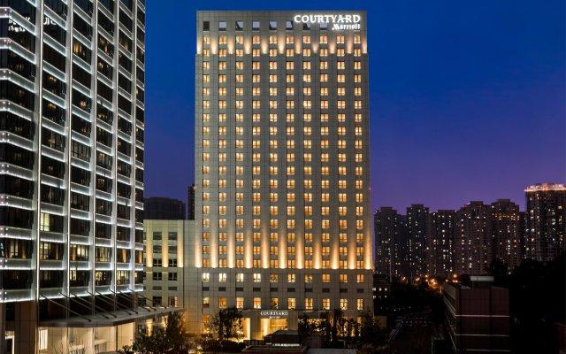 Отель Courtyard by Marriott Tianjin Hongqiao Китай, Тяньцзинь - отзывы, цены и фото номеров - забронировать отель Courtyard by Marriott Tianjin Hongqiao онлайн вид на фасад