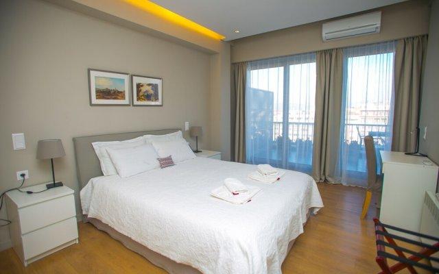 Отель Athens Center Panoramic Flats Афины комната для гостей