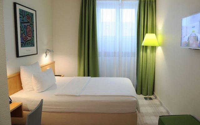 Отель Design Hotel Stadt Rosenheim Германия, Мюнхен - отзывы, цены и фото номеров - забронировать отель Design Hotel Stadt Rosenheim онлайн комната для гостей