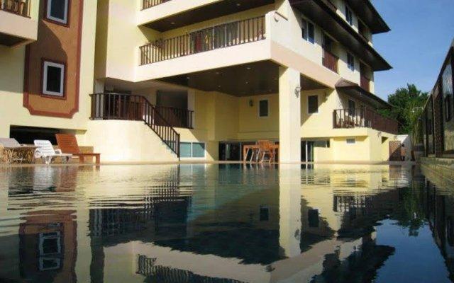 Отель Jomtien Beach Residence Таиланд, Паттайя - 1 отзыв об отеле, цены и фото номеров - забронировать отель Jomtien Beach Residence онлайн вид на фасад