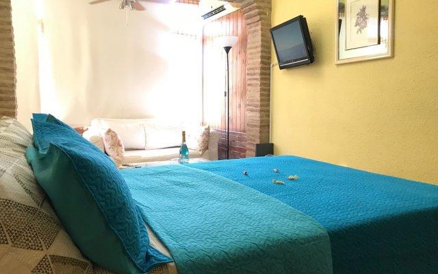 Отель Garajonay Apartamento Торремолинос комната для гостей