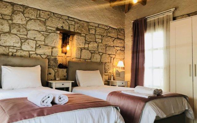 Отель Alacati Cona Butik Otel Чешме комната для гостей