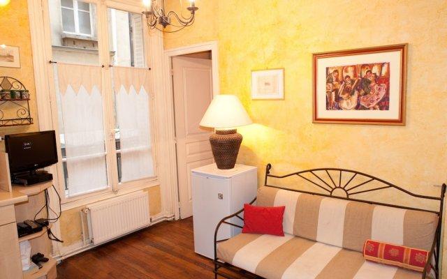 Отель Appartement 2 chambres Париж комната для гостей