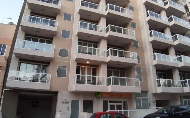 Апартаменты The Village Apartments вид на фасад