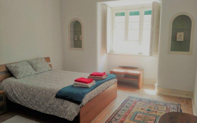Отель Landmark Guest House Лиссабон комната для гостей