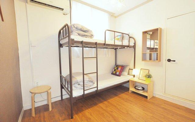 Отель Kimchee Dongdaemun Guesthouse Сеул комната для гостей