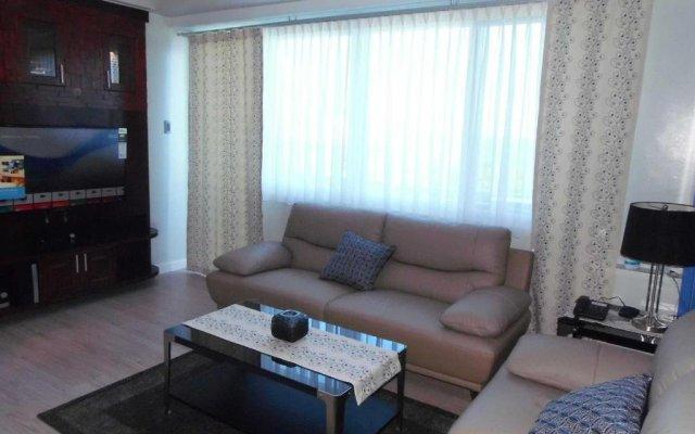 Отель La Mirada Residences Филиппины, Лапу-Лапу - отзывы, цены и фото номеров - забронировать отель La Mirada Residences онлайн комната для гостей
