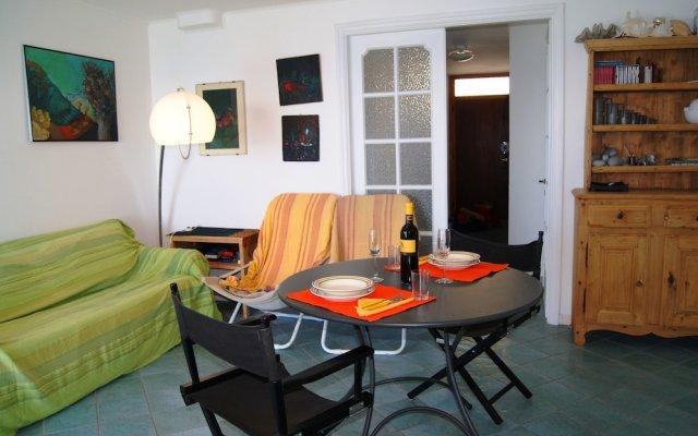 Отель Appartamento Profumo di Mare Костарайнера комната для гостей